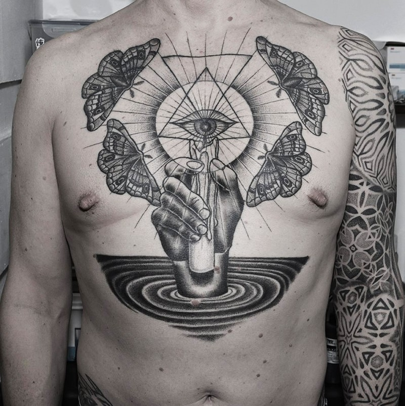 Black ink chest tattoo of mystical eye with butterflies and hand