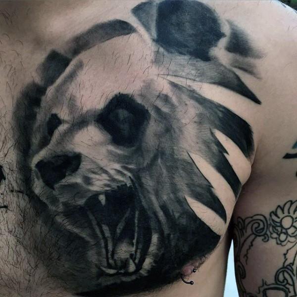 Black ink chest tattoo of roaring panda bear head