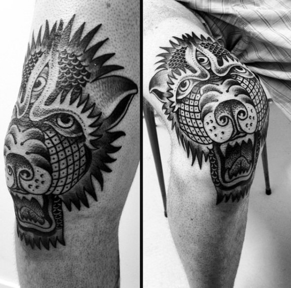 Black ink detailed knee tattoo of demonic dog head