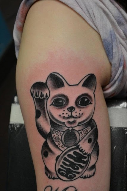 Black ink detailed tattoo of little maneki neko japanese lucky cat with ancient tablet