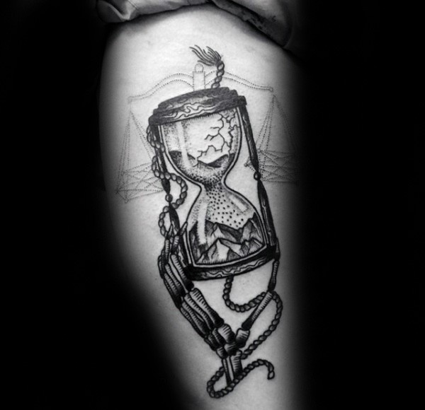 Black ink detailed tattoo of sand clock with skeleton hand and rope
