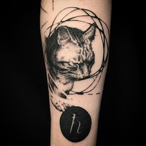 Black ink dot style forearm tattoo of cat with big symbol