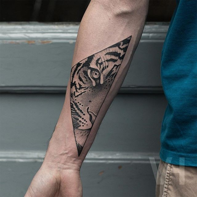 Black ink dot style Valentin Hirsch painted forearm tattoo of tiger face in triangle