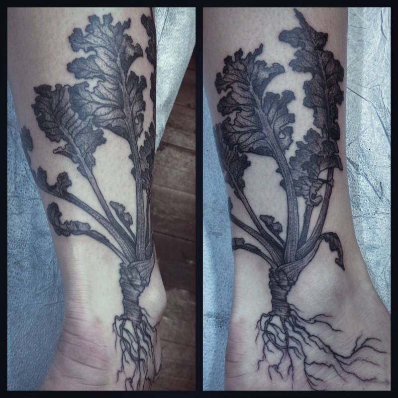 Black ink engraving style ankle tattoo of small plant