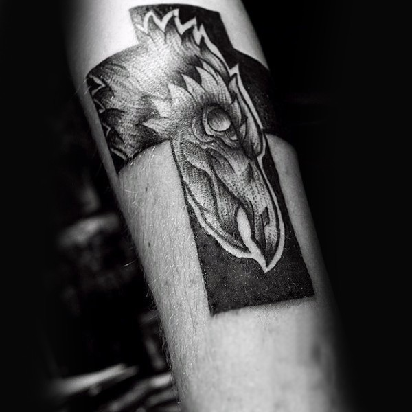 Black ink engraving style arm tattoo of cross with big phoenix bird