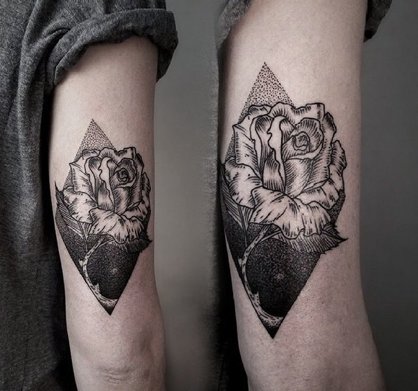 Black ink engraving style arm tattoo of rose with rhombus