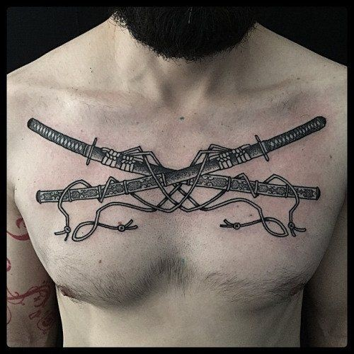 Black ink engraving style chest tattoo of crossed samurai swords