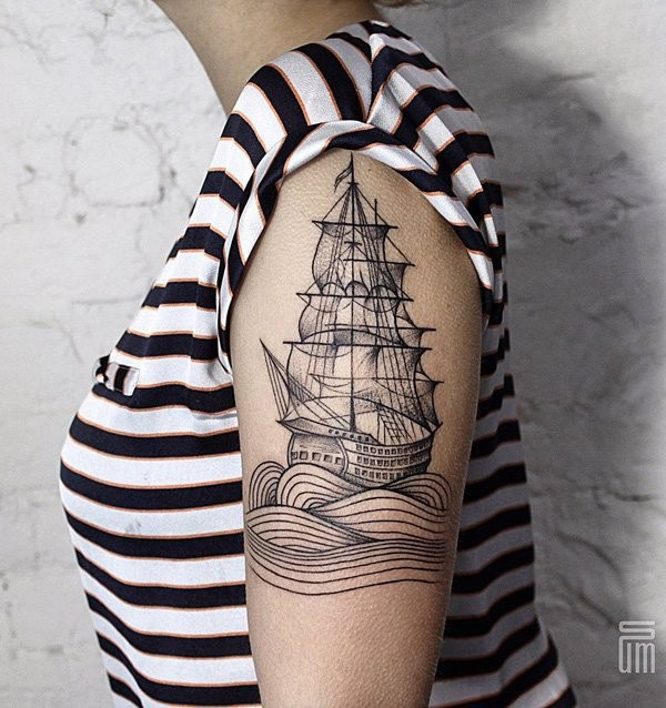 Black ink engraving style shoulder tattoo of simple sailing ship with waves