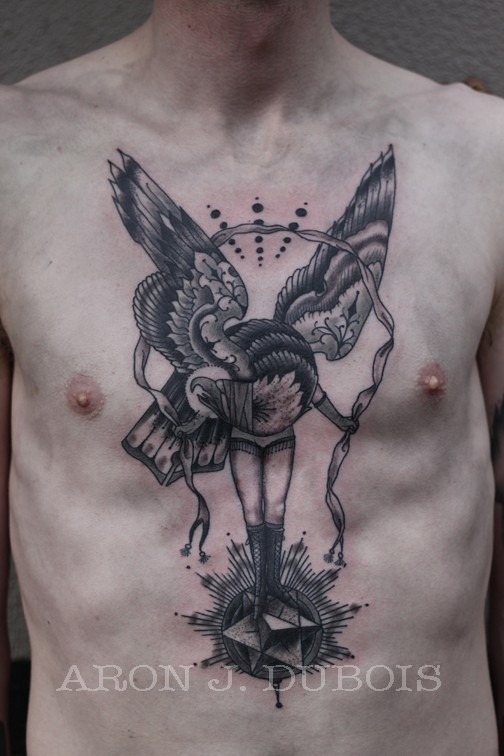 Black ink fantasy style chest and belly tattoo of woman-eagle