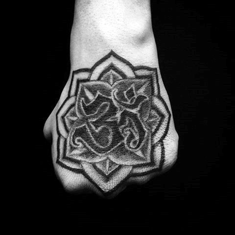Black ink fist tattoo of flower with Asian symbol