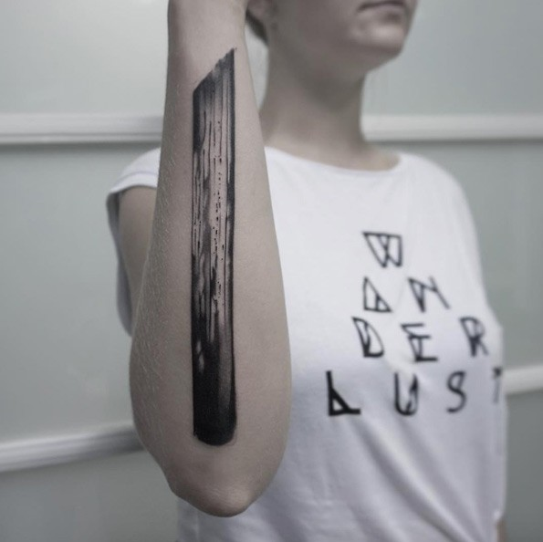 Black ink forearm tattoo of big wooden stick