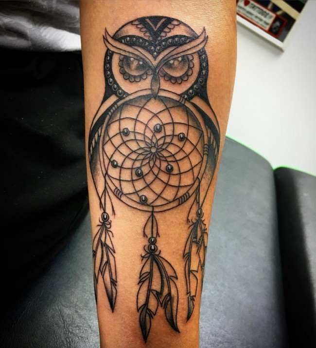 Black ink forearm tattoo of dream catcher and owl
