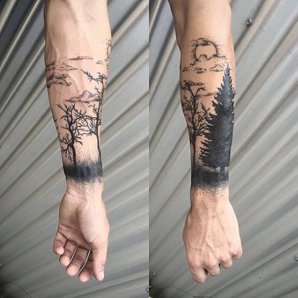 Black ink forearm tattoo of trees and sun