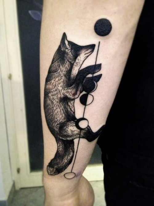 Black ink fox and geometric shapes forearm tattoo