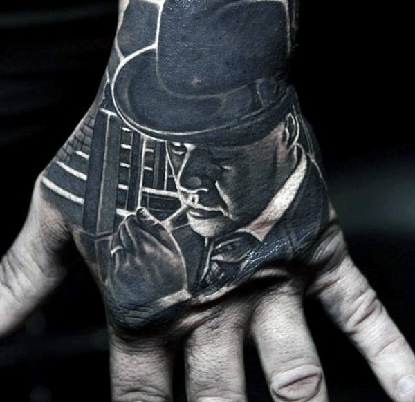 Black ink gorgeous hand tattoo of smoking mafioso