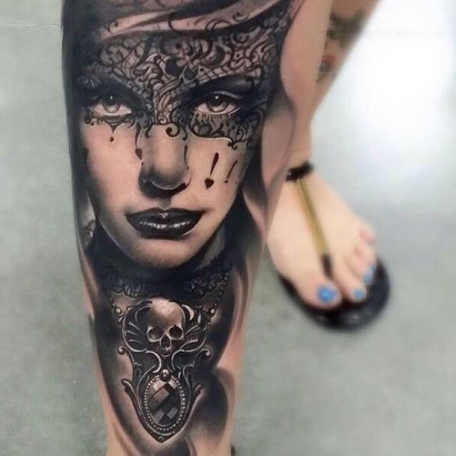 Black ink gorgeous looking arm tattoo of woman with mask and jewelry