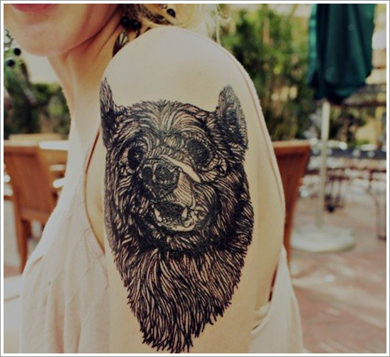 Black ink head bear tattoo on shoulder