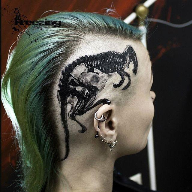 Black ink head tattoo of animal skull