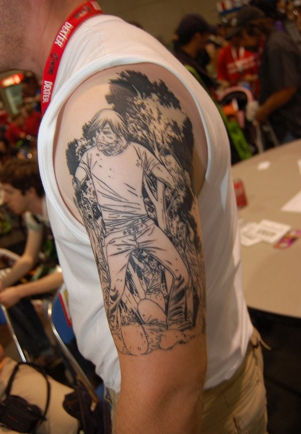 Black ink illustrative style man with zombies tattoo on shoulder