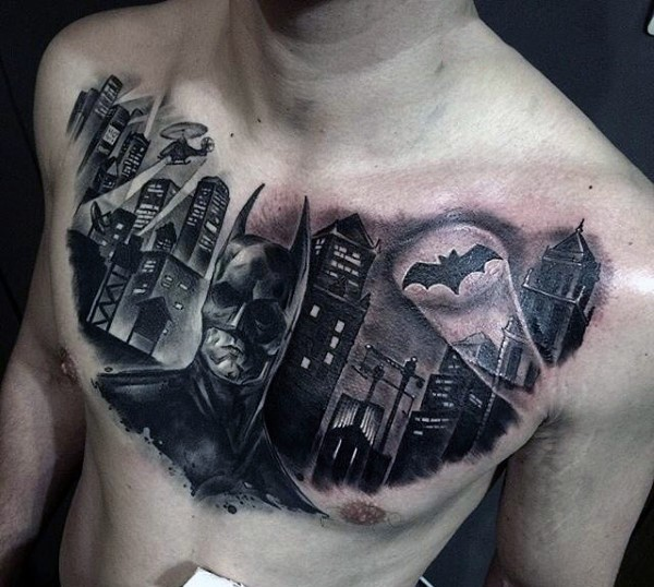 Black ink incredible looking dark Batman with city tattoo on chest