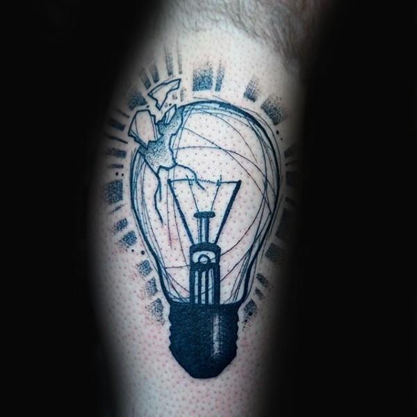 Black ink large leg tattoo of broken bulb