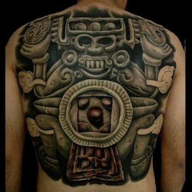Black ink large whole back tattoo of ancient stone statue