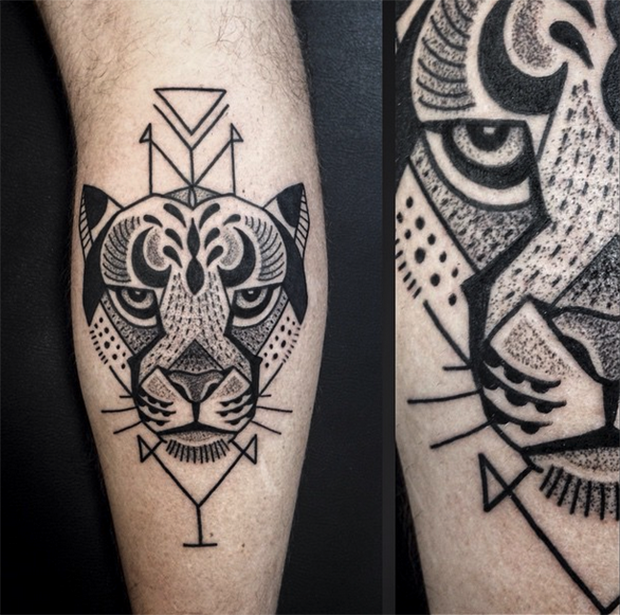Black ink leg tattoo of tiger head with geometrical figures