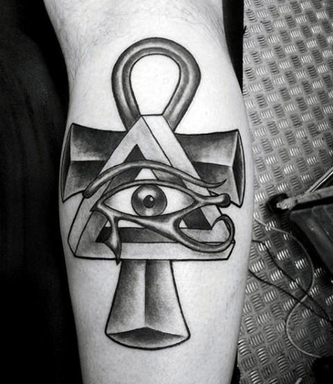Black ink leg tattoo of various Egypt symbols