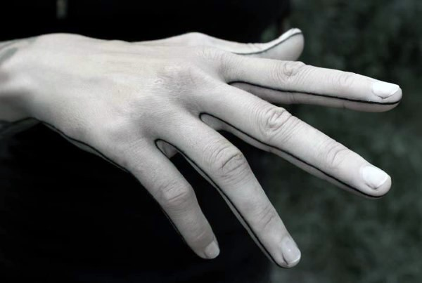 Black ink lines tattoo on hand and fingers