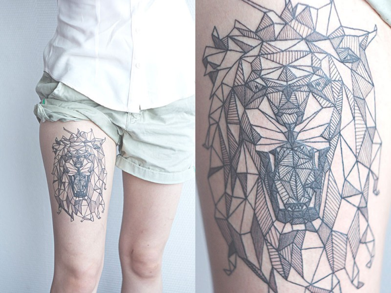 Black ink linework style thigh tattoo of roaring lion