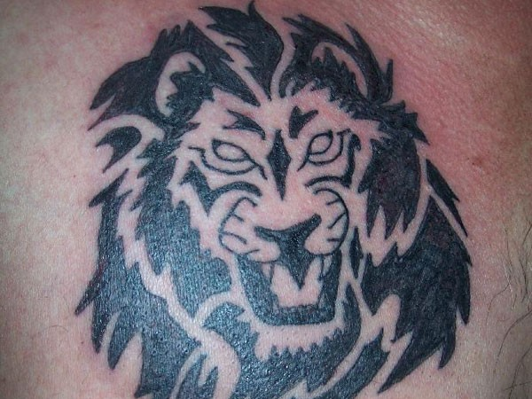 Black ink lion head tattoo