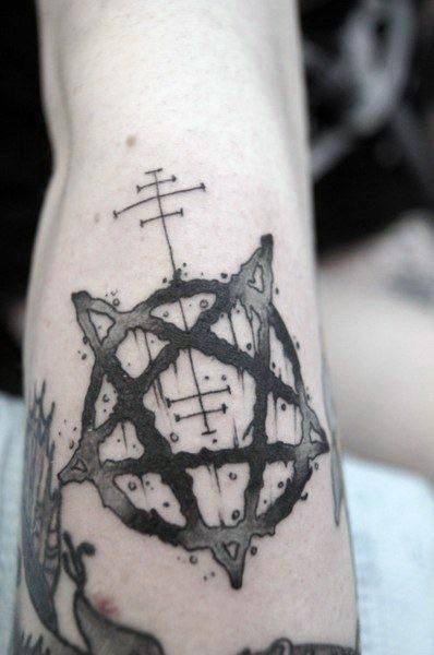 Black ink medium size devils star tattoo on leg