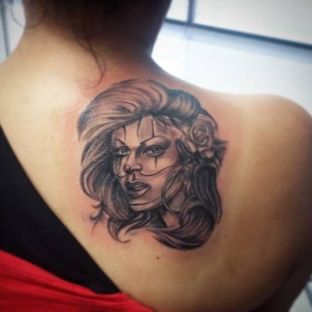 Black ink Mexican traditional upper back tattoo of woman portrait