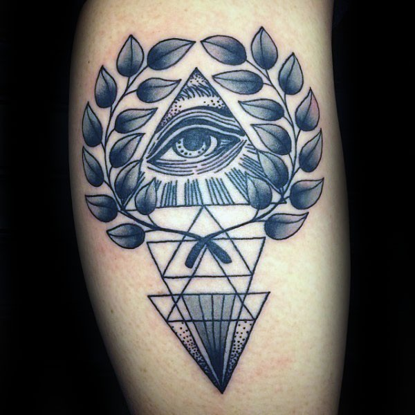 Black ink mystical ornament tattoo with leaves and triangles