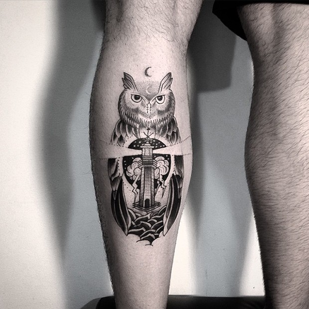 Black ink original combined leg tattoo of owl with lighthouse