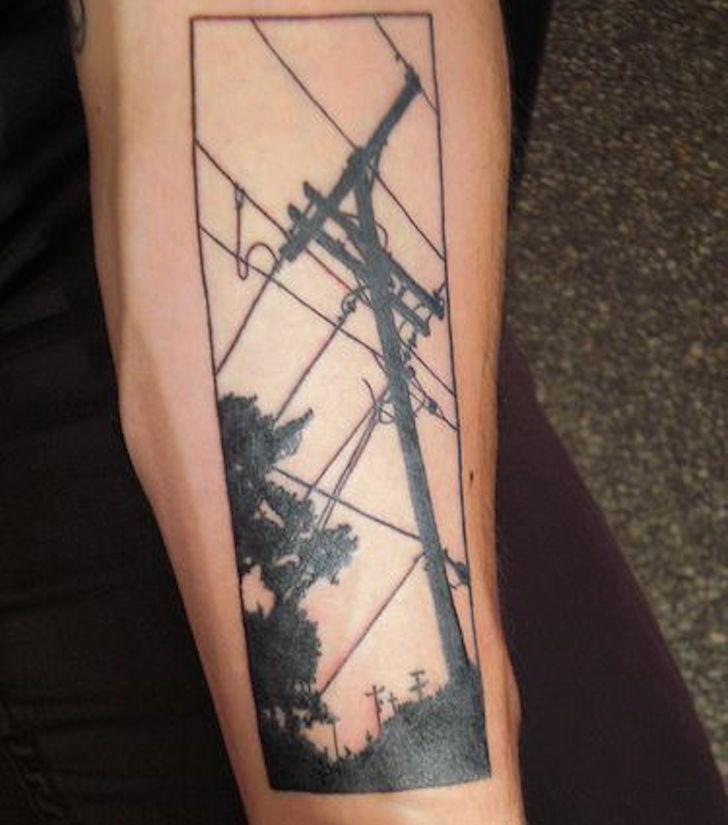 Black ink original looking lineman lines tattoo on forearm