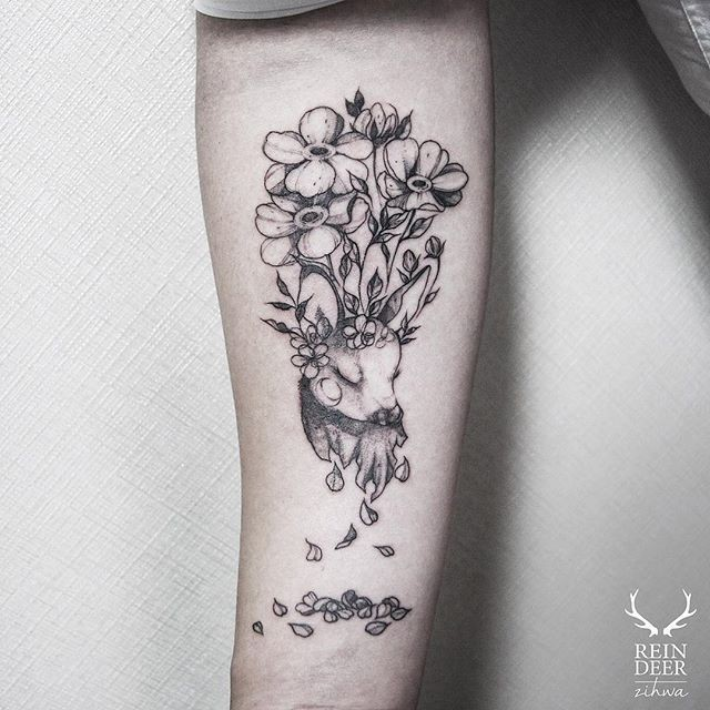 Black ink painted by Zihwa forearm tattoo of deer head and flowers