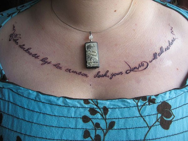 Black ink quote chest tattoo