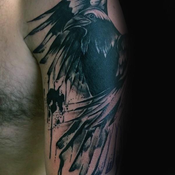 Black ink shoulder tattoo of dark crow