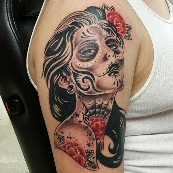 Black ink shoulder tattoo of Mexican woman with tattoos and flowers