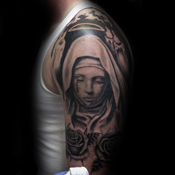 Black ink shoulder tattoo of saint woman with roses