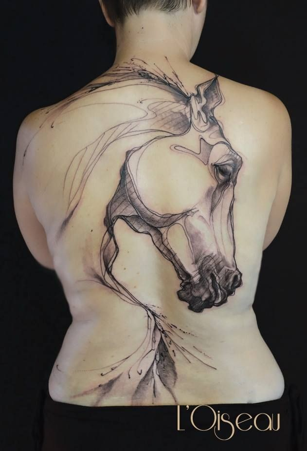 Black ink sketch style back tattoo of big horse head