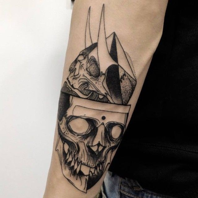 Black ink sketch style painted by Michele Zingales arm tattoo of human skulls with horns