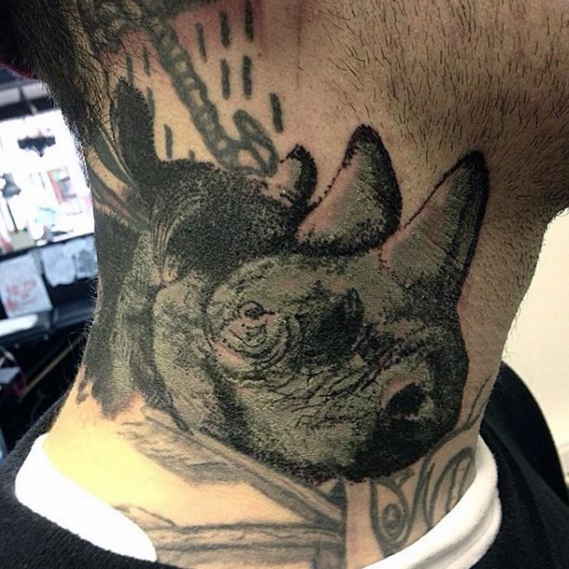 Black ink small vintage style neck tattoo of rhino head