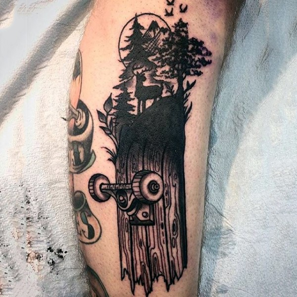 Black ink spectacular looking leg tattoo of wooden skateboard and trees