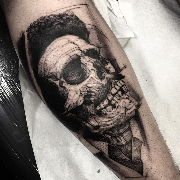Black ink stippling style forearm tattoo of skull with mustache
