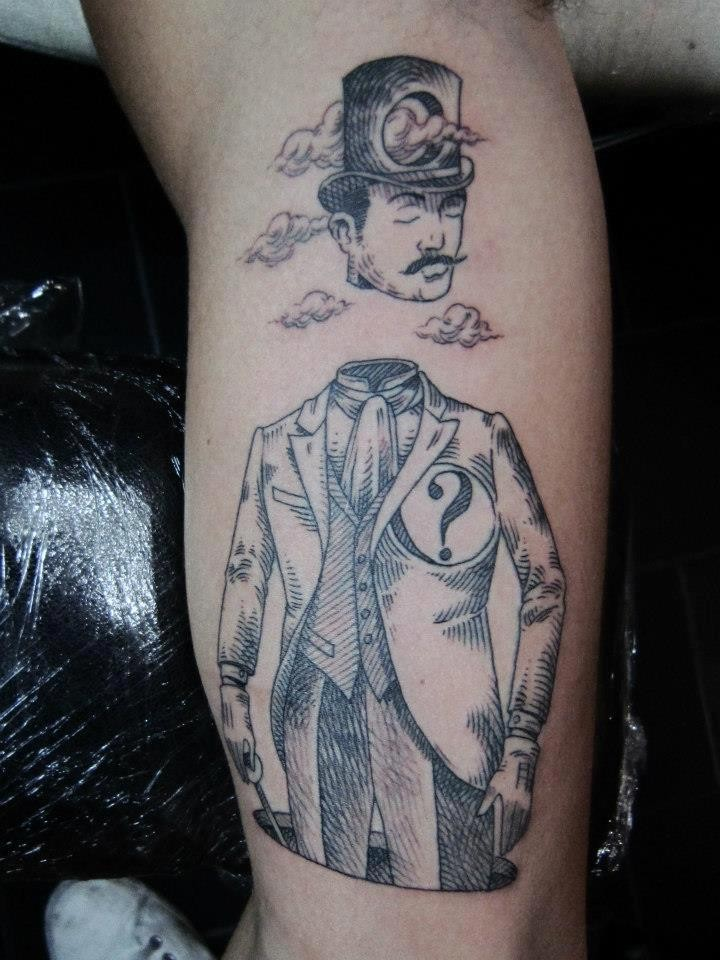 Black ink surrealism style arm tattoo fo man with divided head and clouds