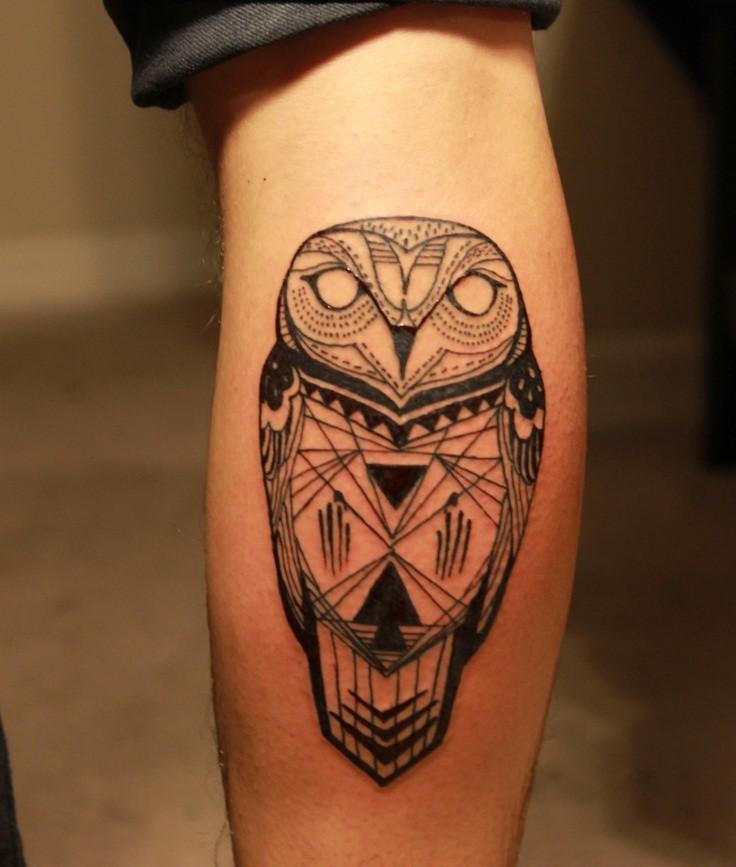 Black ink totem owl tattoo on leg