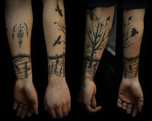 Black ink tree and birds tattoo on forearm