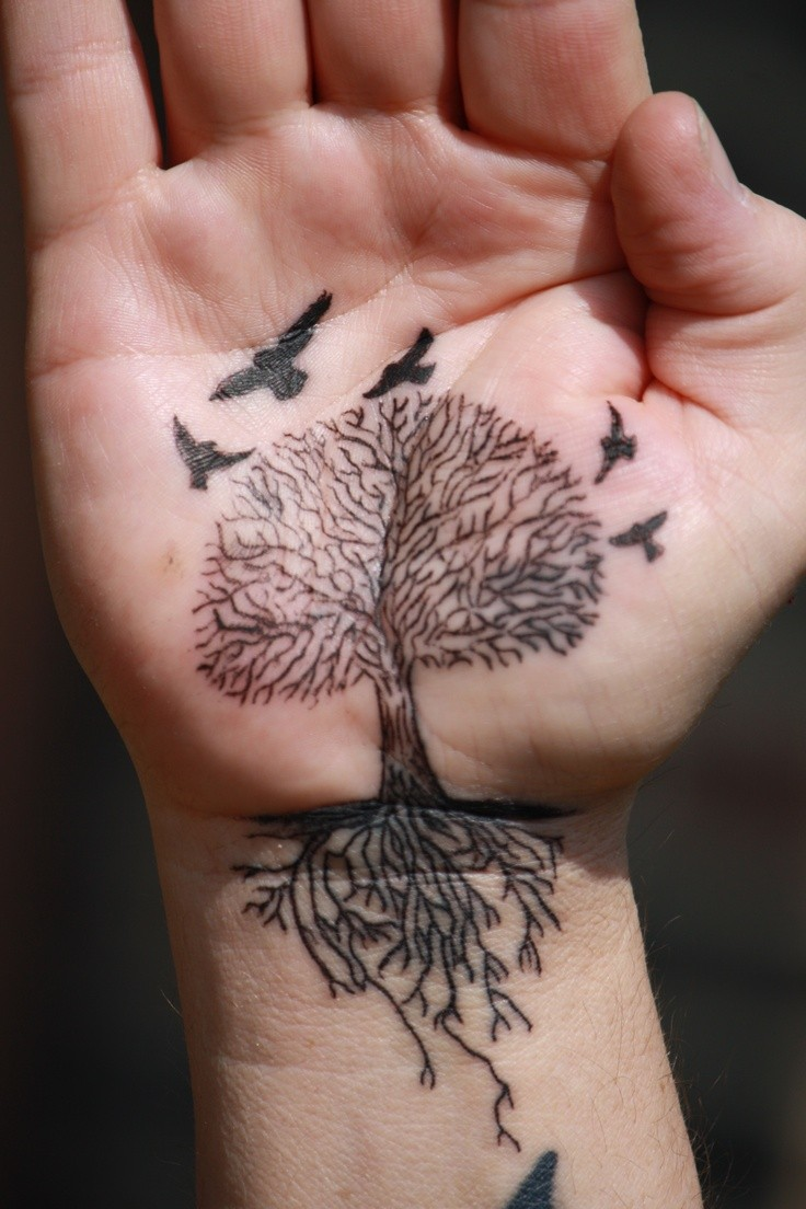Black ink tree with roots and birds tattoo